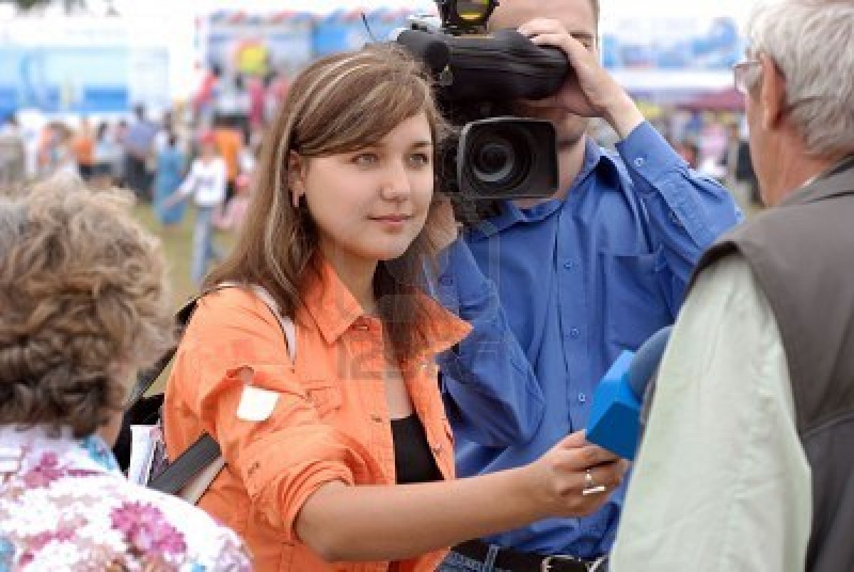 4820087-female-reporter-is-interviewing-on-baikal-day-on-august-3-2008-at-baikal-lake-buryatia-russia.jpg